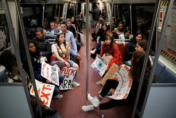 Students from Washington-Lee High School in Arlington, Virginia, join the National School Walkout while riding the Metro subway system to the US Capitol in Washington, DC.