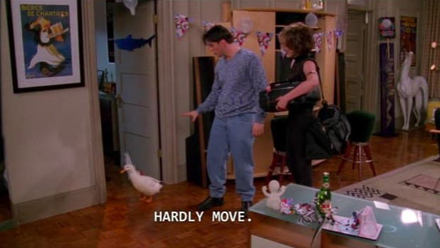 """The partition to Joey's """"bedroom"""" being visible in this scene."""