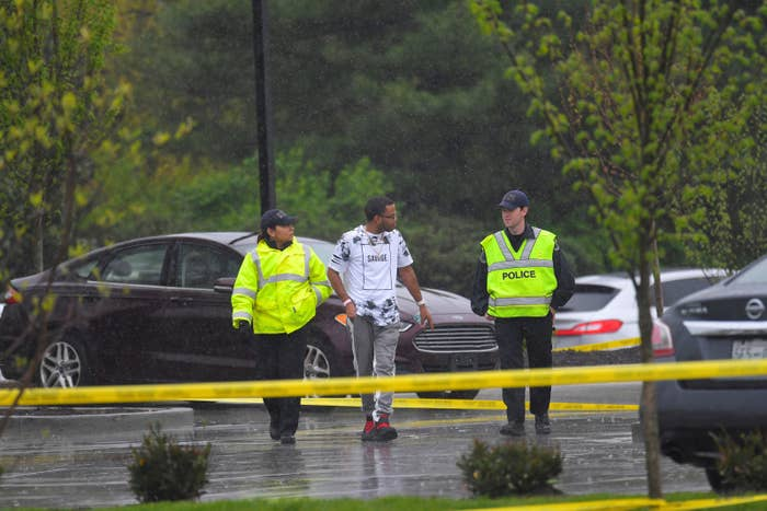 Metro Davidson County Police escort a man to his car at the scene of a fatal shooting at a Waffle House restaurant near Nashville, Tennessee.