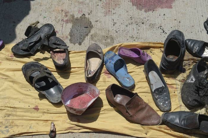Abandoned shoes belonging to victims of a suicide bombing at the scene of the attack outside a voter registration center in Kabul, Afghanistan, on April 22, 2018.