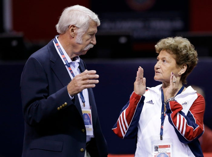 Bela and Martha Karolyi talk on the arena floor before the start of the preliminary round of the women's Olympic gymnastics trials in San Jose, California.