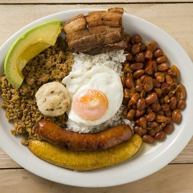 What is it: The quintessential Colombian dish with origins in the state of Antioquia. It's a platter with a combination of red beans, a fried egg, avocado, fried plantains, chicharron, rice, ground beef, and pork sausage. Food combinations vary greatly, but this is what typically comes in the platter. Taste: A culinary rainbow of Colombia. Conclusion: Skip the diet and just eat it. Get a recipe here.
