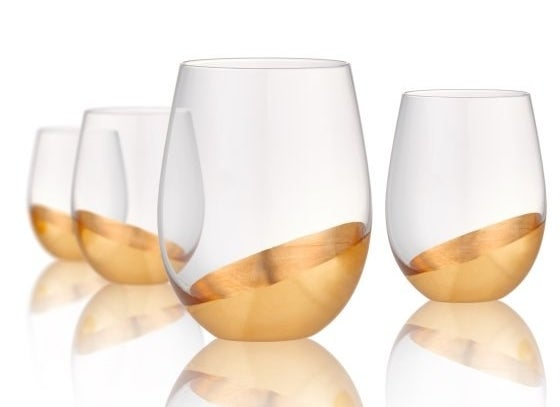A set of stemless wine glasses with dip gold-colored bottoms for feeling luxe AF on a budget.
