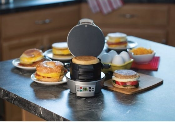 A sandwich maker that cooks every part of the breakfast sandwich at once, so you can have breakfast faster than it would take to order something from a drive-through window.
