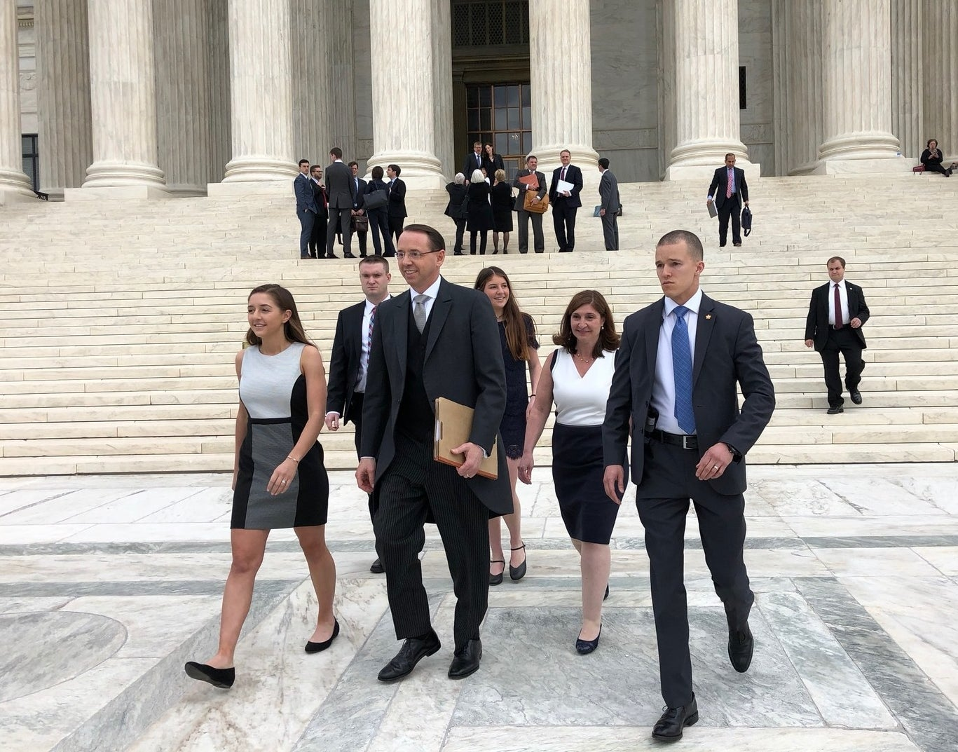 Deputy Attorney General Rod Rosenstein leaves the Supreme Court with his family after arguing before the justices on Monday.