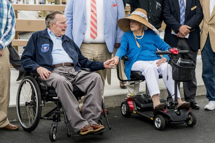 George and Barbara Bush hold hands before the dedication of the Mathew J. Lanigan Bridge in Kennebunk, Maine, on May 19, 2017.