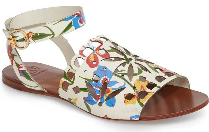 e224a61c8be3 An adorable pair of floral cutout Tory Burch sandals to help give your  everyday look a little tropical flair.