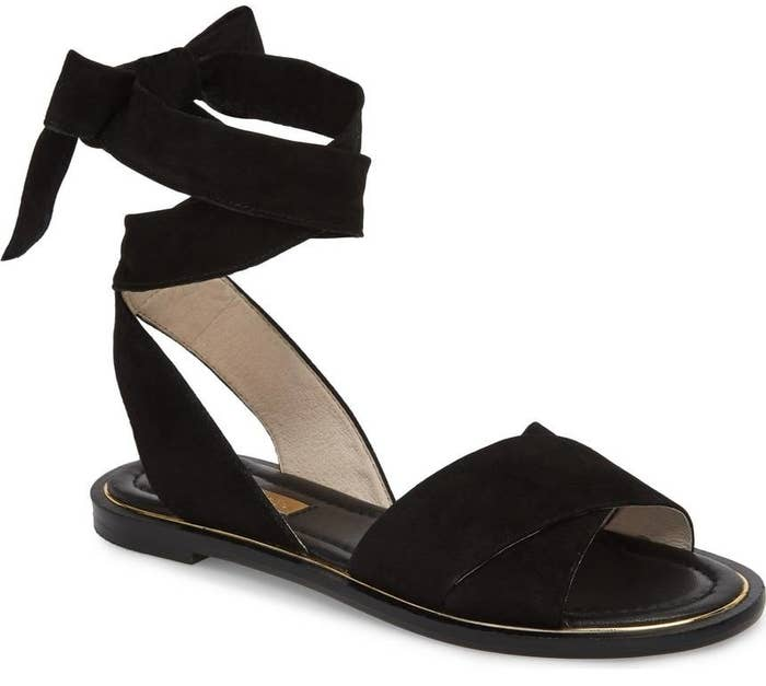 f1dac7dad27b49 A pair of Louise et Cie ankle wrap sandals made with a buttery-soft ribbon  lace and a lightly cushioned footbed.