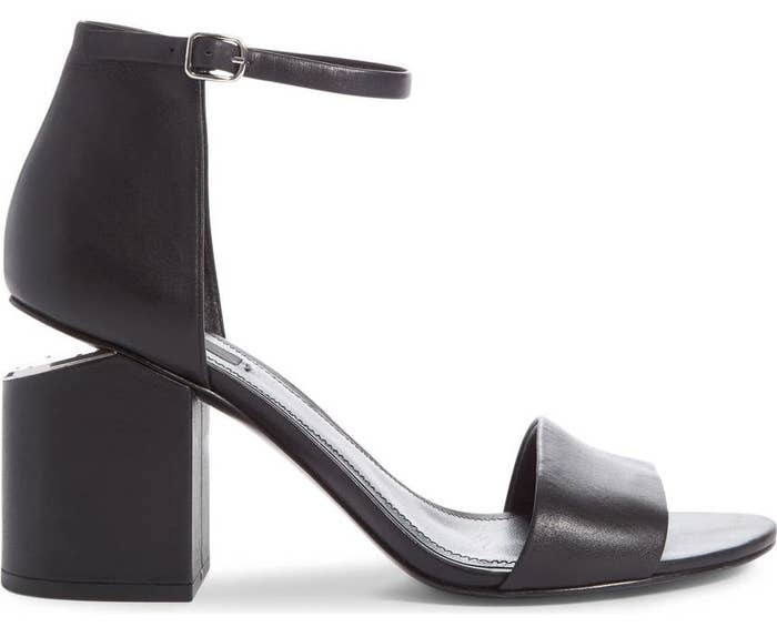60ff13782af5 A pair of leather Alexander Wang cutout heel sandals for a perfect black  sandal you can wear all summer long.