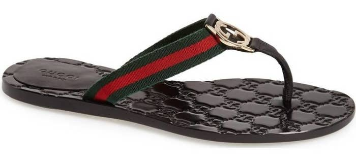 7b8fbc8fa22345 A pair of embossed leather Gucci flip-flops