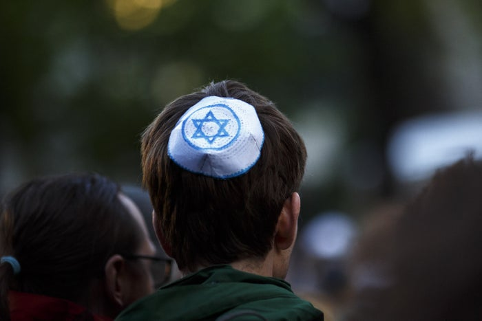 In cities across the country, many protesters showed their solidarity with the estimated 200,000 Jews inside Germany — including 100,000 in Berlin alone — by donning the skullcaps, also known as a kippah in Hebrew.