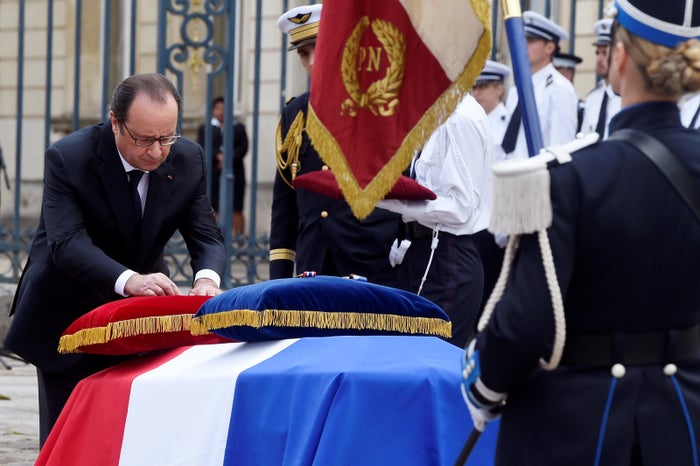 France's then-president François Hollande at the funeral for Salvaing and Schneider in 2016.