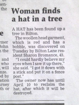 A woman who found her hat in a tree: