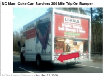 A Coke can on the back of a U-Haul: