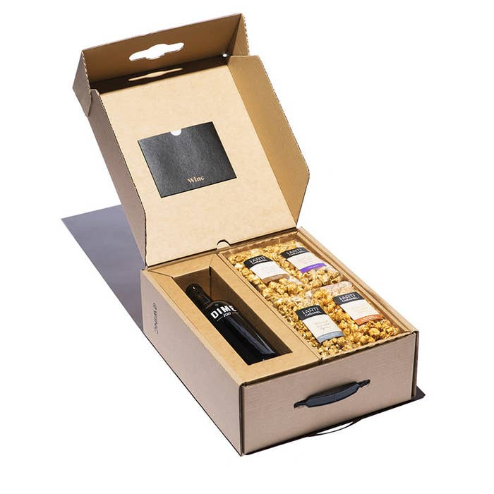 fcafef88ced A gift set with a bottle of wine and plenty of caramel popcorn to make  movie night even sweeter.