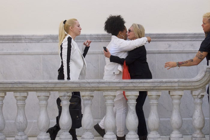 From left: Bill Cosby accusers Caroline Heldman, Lili Bernard, and Victoria Valentino react after the guilty on all counts verdict was delivered in the sexual assault retrial at the Montgomery County Courthouse on April 26, 2018, in Norristown, Pennsylvania.