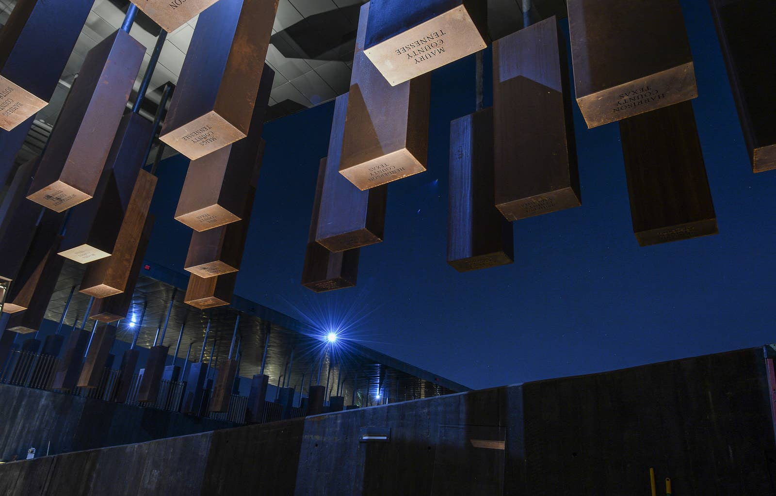 Names and dates of lynching victims are inscribed on corten steel monuments, representing each county in the United States where a lynching took place. More than four thousand victims are honored at the memorial.
