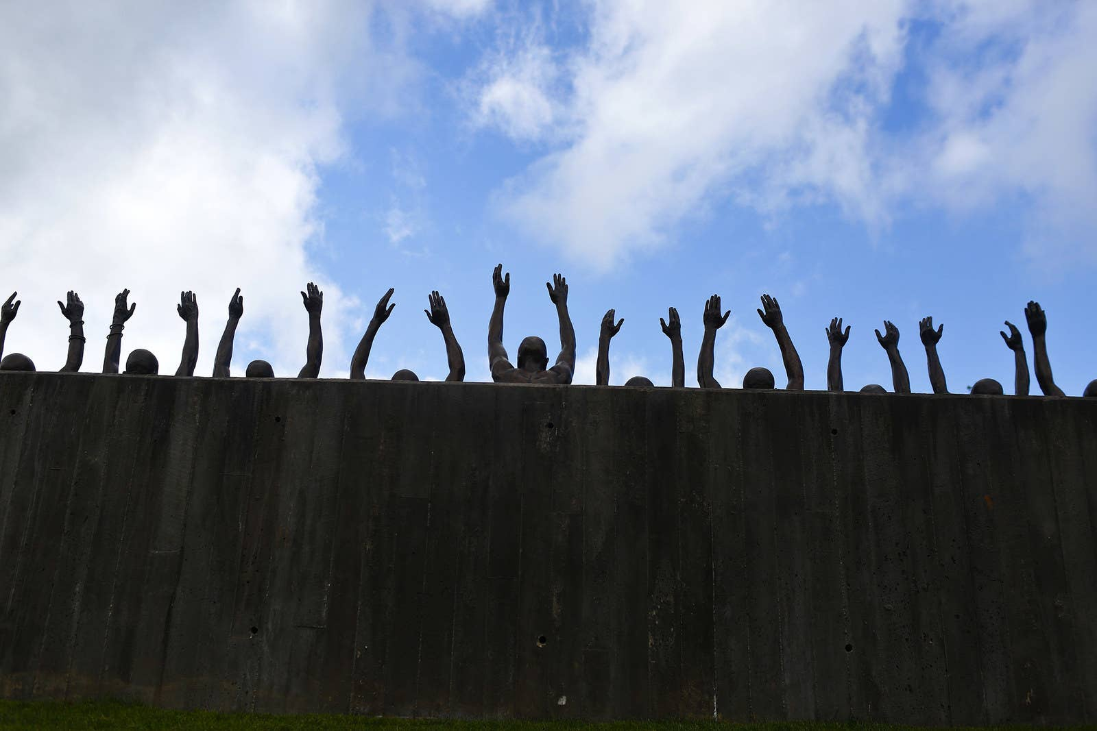 """A bronze statue called """"Raise Up"""" is displayed to honor the thousands of people killed in racist lynchings."""