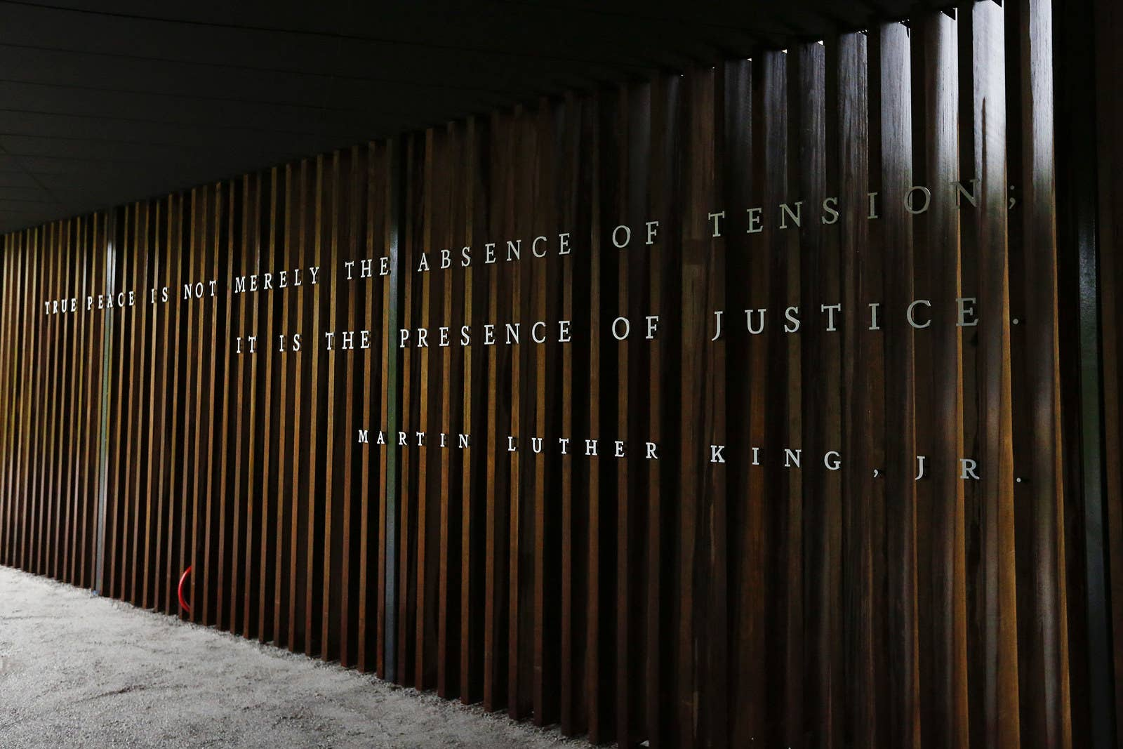 A quote by Martin Luther King Jr. is on display on the inside walkway of The National Memorial for Peace and Justice.