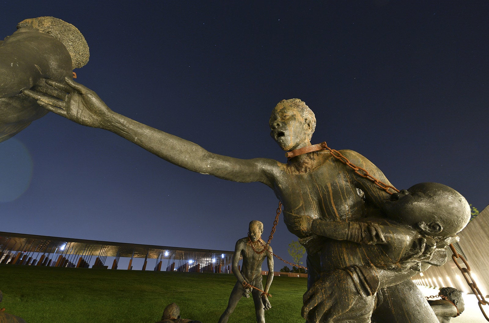 A sculpture by artist Kwame Akoto-Bamfo of enslaved people in chains at The National Memorial for Peace and Justice.