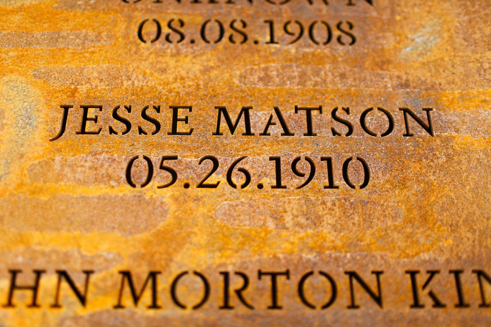 The name of a lynching victim is inscribed alongside the date of his death.