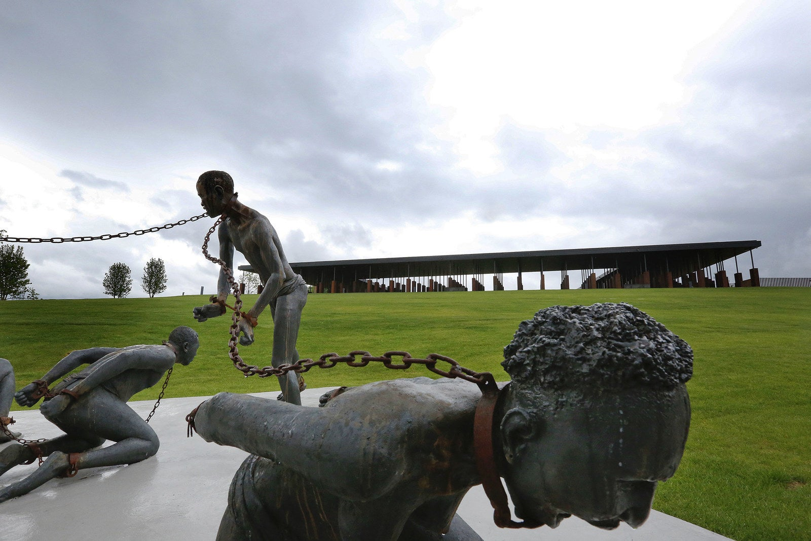 A sculpture by artist Kwame Akoto-Bamfo depicts people enslaved and suffering.