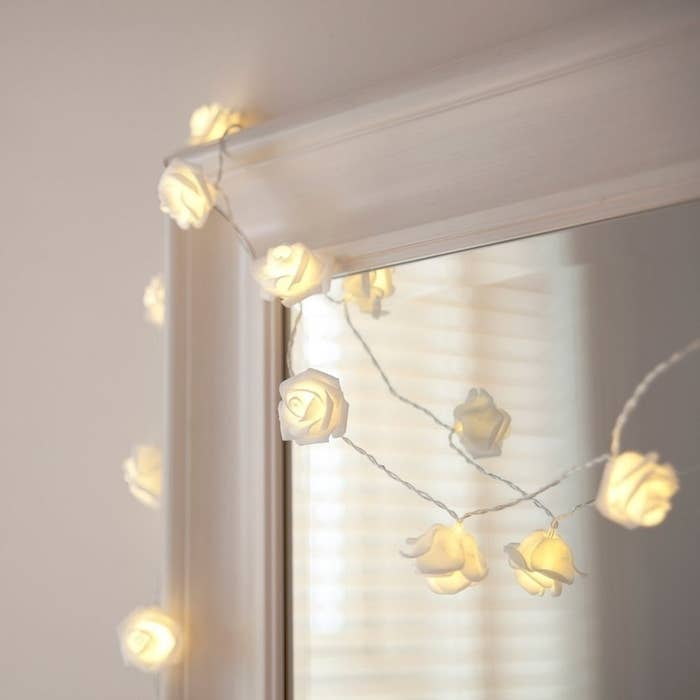 """Promising review: """"For some reason I thought these were glass (I read it wrong) but they are actually a fake, soft flower. They're better than what I thought they were going to be! I have them wrapped around my bedroom mirror and they are gorgeous. They have so many different light settings that I don't know which one I like best!"""" —CaraGet them from Amazon for $9.99."""