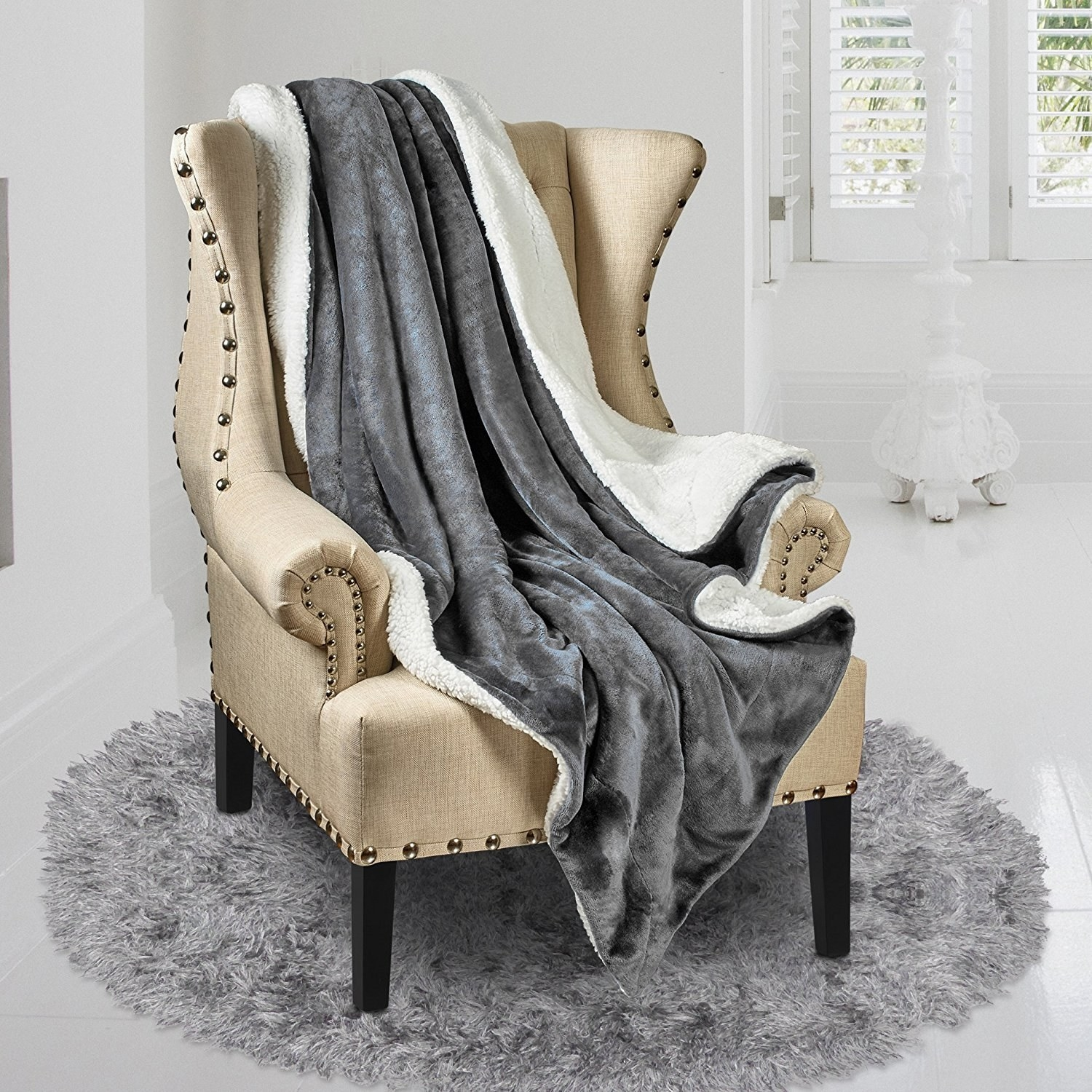 blanket styled and draped over a chair