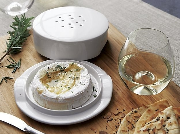 brie dish styled on table with brie cheese inside