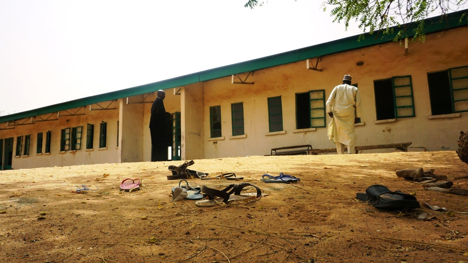 Sandals are strewn in the yard of the Dapchi Girls Science and Technical College staff quarters in the wake of the abduction.