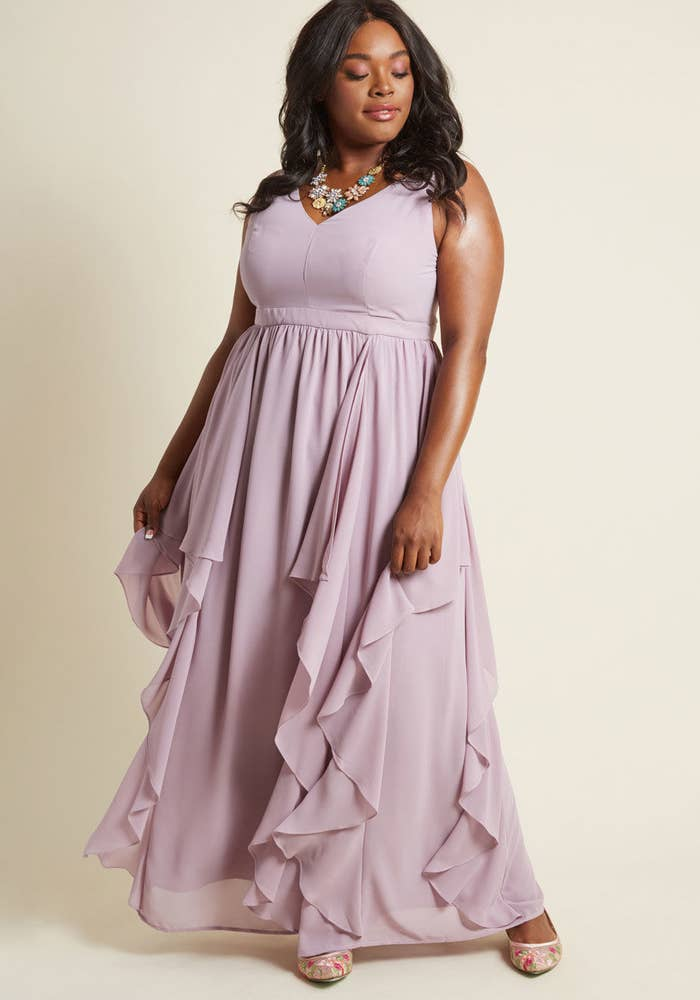f226993227b A flowing gown conveniently designed to match the venue and theme for every  wedding you ll be attending this year.