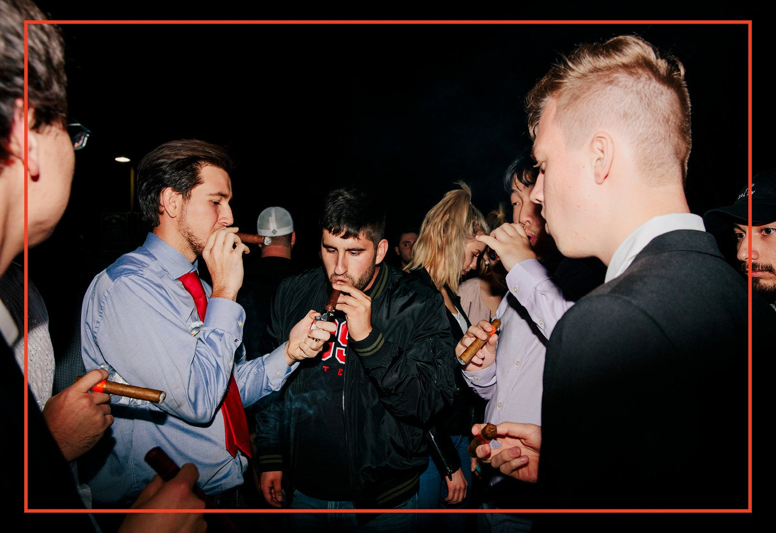 Members of the California College Republicans light and smoke cigars at the cigar social event on the first night of the three-day convention in Santa Barbara, California on April 6, 2018.