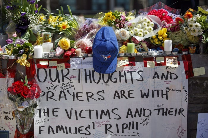 Tributes are seen on a memorial at Yonge Street and Finch Avenue in Toronto.