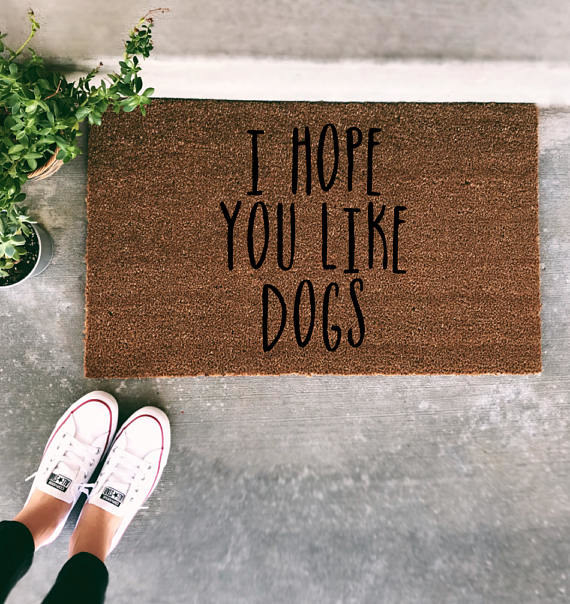 """door mat that says """"i hope you like dogs"""""""