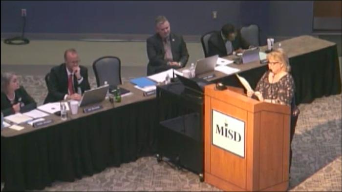Lisa Duhamel addressing the school board meeting.