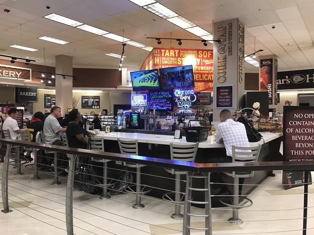 A bar in the middle of a grocery store