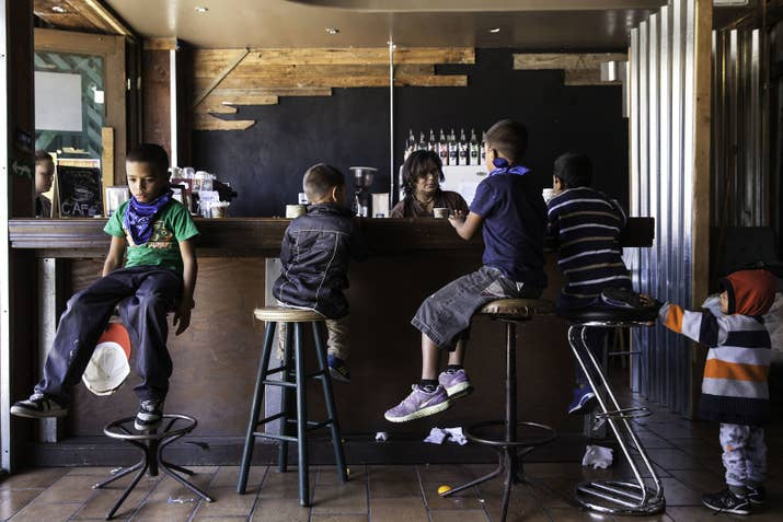 Children at a cafe in Tijuana as family members speak to an attorney about seeking aslyum in the United States.