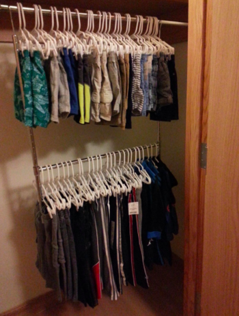 two rows of clothing in a reviewer's closet
