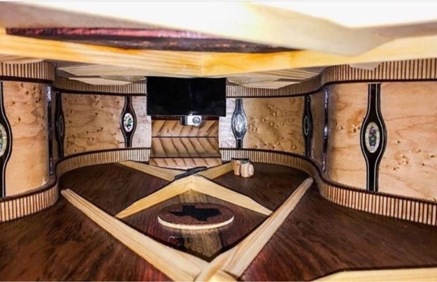 The inside of this guitar that looks like a bougie lounge.