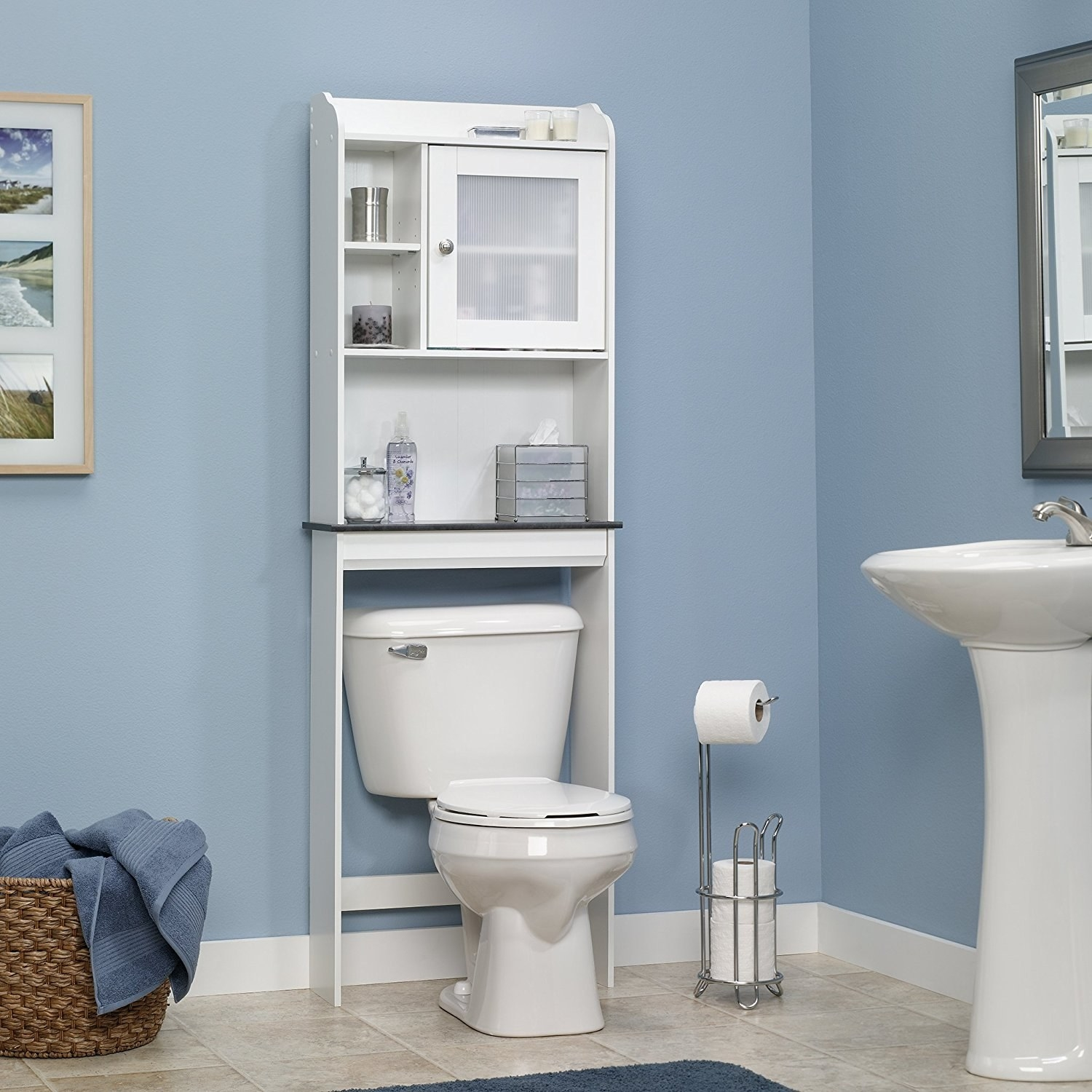 A shelf slid behind a toilet with a main counter above the toilet tank, which sits below medicine cabinet on the right and two shelves on the left. There is also shelf-space on the top of the cabinet