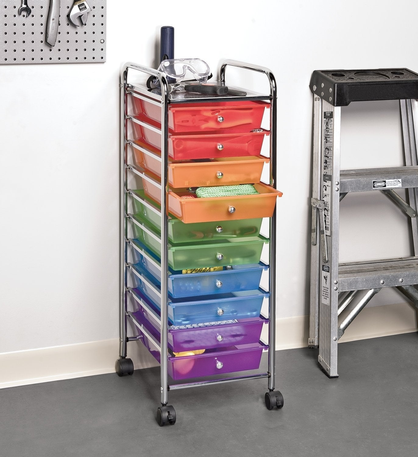a ten drawer wheely shelf with two drawers in each color of the rainbow except yellow