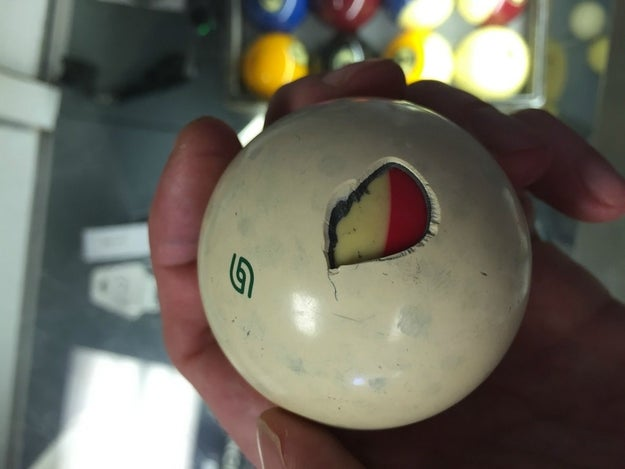 This cracked cue ball that's got another pool ball inside of it.
