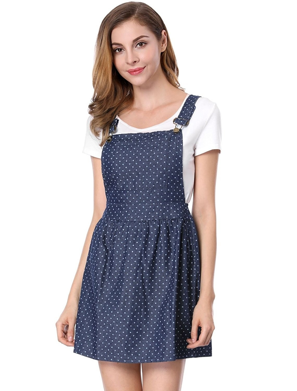 A model wearing the dark denim mini with white polka dots