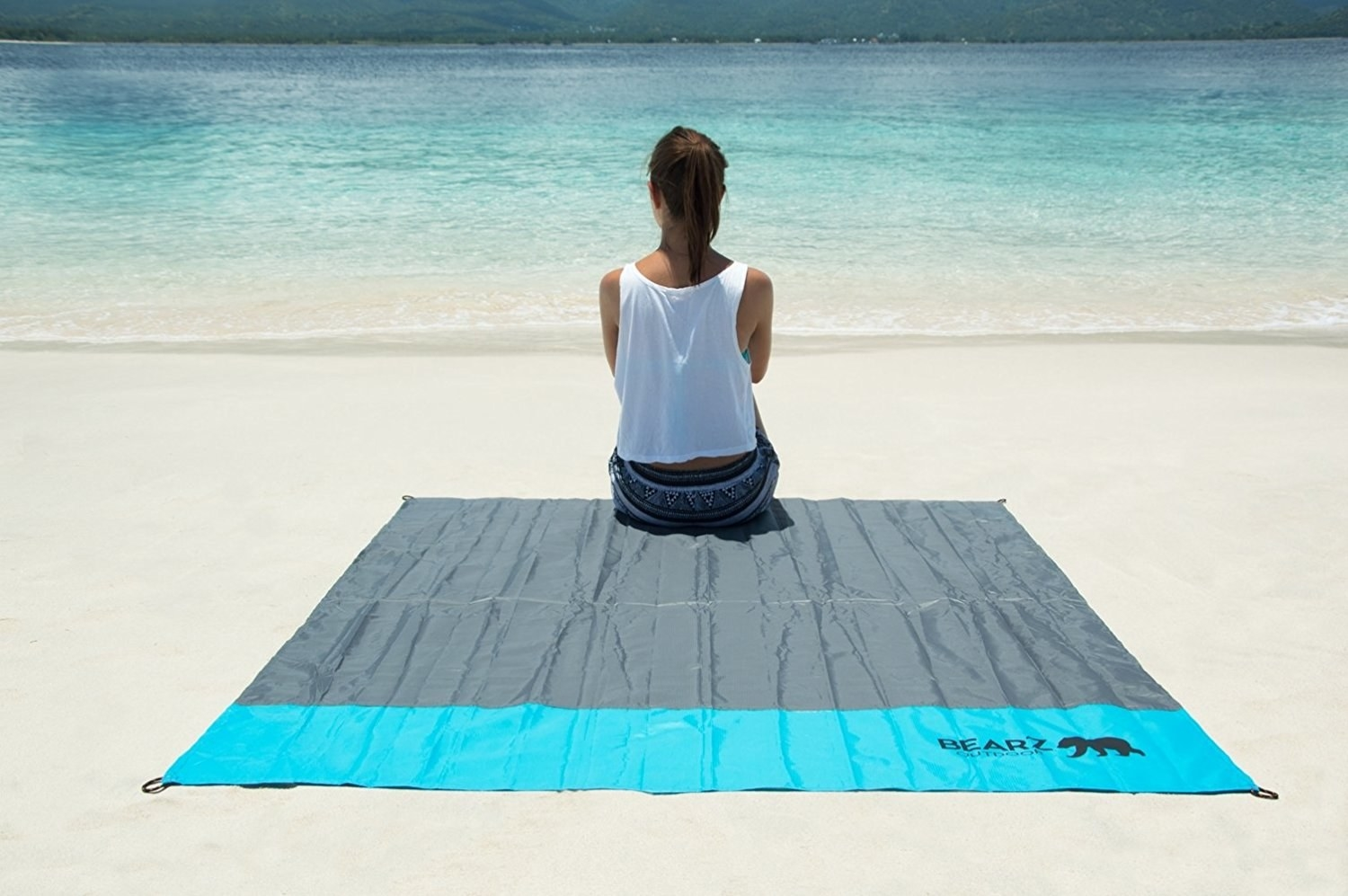 person sitting on blanket