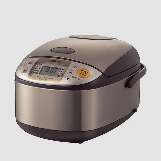 """Promising review: """"If you're pressed for time and you cook a lot of rice or other boiled/steamed grains, BUY THIS RICE COOKER. I would give it more than five stars if I could. It's a triumph of convenience engineering. I've owned a couple $20 rice cookers, which I used when I didn't have enough time to spare to pay attention to heat-on, heat-off cycles when I was making a meal. Now, I just select the type of grain from a super-intuitive menu, select the time I want it ready, and push a button. The rice is always perfect when the beeper goes off, and is still perfect the next day."""" —Kringle Get it from Amazon for $170.99 (available in 5.5- and 10-cup) or get a similar one from Amazon for $18.92+ (available in black and red)."""