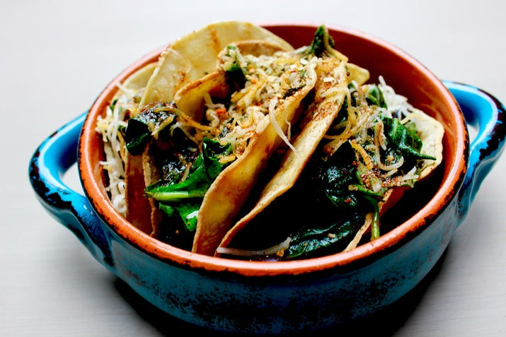These delicious tacos are filled with spinach, cheese, and protein-packed black beans. Get the recipe here.
