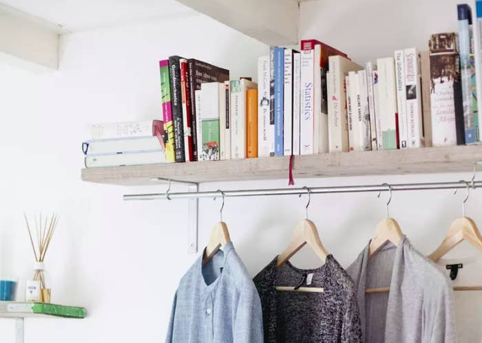 Mount A Hanging Shelf Then Make It Double As Clothing Rack