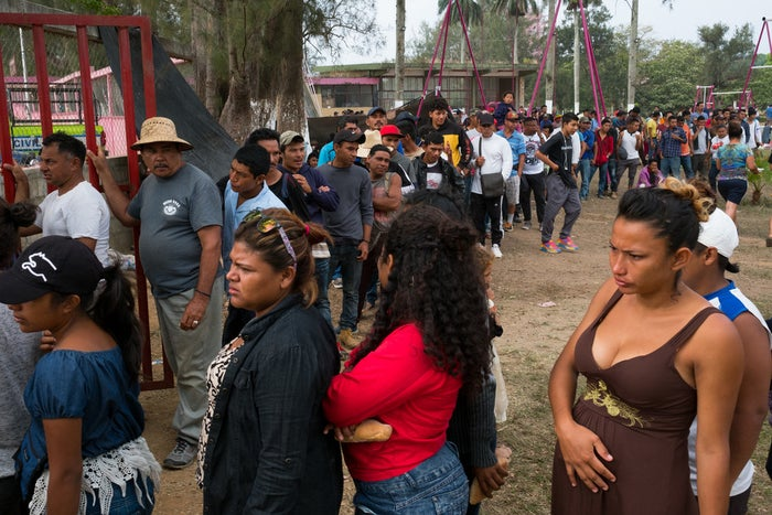 Members of a caravan moving through Mexico stand in line for food in Oaxaca.