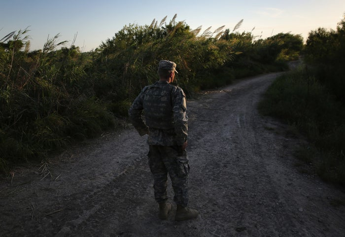 A Texas National Guard soldier monitors a road near the US–Mexico border on Sept. 11, 2014, in Havana, Texas.