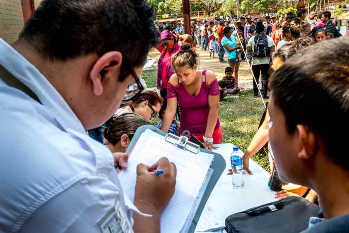 Mexican immigration officials take details for migrants who have not yet received their temporary transit visas.